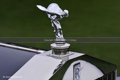 KHI stock photos of collector vintage Rolls-Royce Phantom II winged female hood ornament chrome radiator cap.