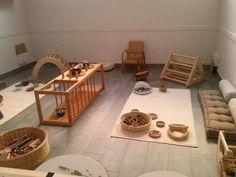 Use of sturdy furntiure, homelike, not too bright.... lots of manipulatives... gross/fine and space to move around...