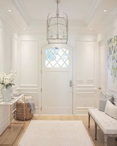 @JSHOMEDESIGN- diamond pane door. Foyer, entryway, traditional home, wisteria console table, circa lighting, lantern pendant, benjamin moore, simply white, foyer bench, tray ceiling, diamond accent door, hardwood floors, wide plank hardwood. Mixing metals, gold side console table, ginger jar