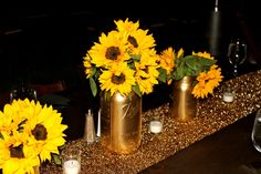 Event produced by Kapture Vision. table setting, sunflowers, centerpieces, candles, nature, Camp Retreat