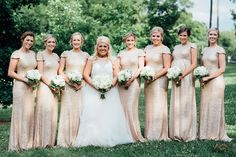 A glamorous bridal party: the bride chose long sparkly gold bridesmaid dresses with short sleeves and traditional white rose wedding bouquets for her best ladies.