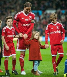 Outnumbered: Harper commanded the boys' attention as they headed off the pitch...