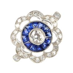 Flower Sapphire Diamond Engagement Ring | From a unique collection of vintage cluster rings at https://www.1stdibs.com/jewelry/rings/cluster-rings/