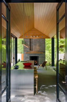 stainless,wood, stone,nature....Nevis Pool and Garden Pavilion / Robert M. Gurney, FAIA Architect