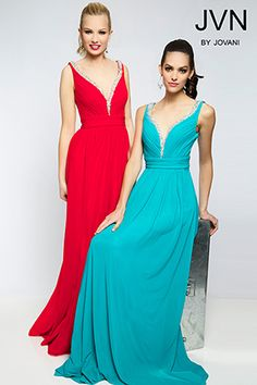 This gown has a deep V neck and sheer nude insert at the neckline   The beading on the neckline and back is classic   We have this in both colors shown