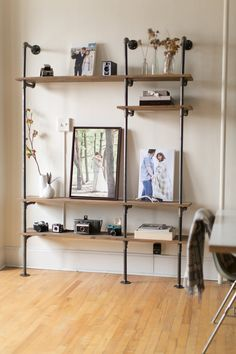 Everytime I see piping shelves, I drool. I want them EVERYWHERE and freaking love the look of them. Talk about a cheap, industrial solution to having so many towels/pictures/books/shoes/canned goods.