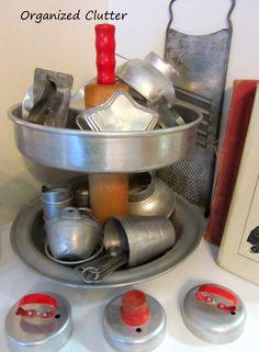 A Re-purposed Kitchen Ware Tiered Stand www.organizedclutterqueen.blogspot.com