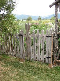 Peter Rabbit& Garden (picket fence) If this was mine I would paint the fence white and the bunny pink with a pink and white bow Garden Gates And Fencing, Fence Gate, Rabbit Garden, Rabbit Fence, My Secret Garden, Garden Structures, Outdoor Structures, Dream Garden, Yard Art