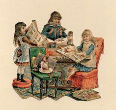 three girls working on scrap books