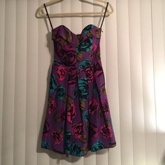 Betsy Johnson Purple Floral A-Line Party Dress Worn only once. Silk, purple with pink and turquoise floral pattern. Strapless, zipper on left side, and a ribbon to tie in the back. The stretchy back makes it an easy fit (see photo for reference). I have a larger chest and it fits me. A really beautiful find, perfect for parties or for a nice night out!! All prices are negotiable!! Betsey Johnson Dresses Strapless