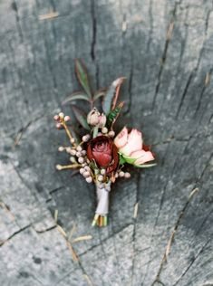 A fall inspired boutonniere in a burgundy/blush style.