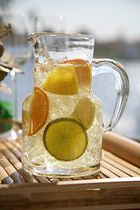 Simple White Wine Citrus Sangria Recipe... I want to try the Argentine 'NEW AGE' White wine for this.... (it might be the ruin of a good wine but I'm curious).