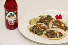 Love your taste buds with juicy Tacos and a Jarritos Jamaica! tacos, meat, bbq, carne aside, mexican food, grill, grilled meat, mexican fiesta, mexican party, party ideas, cooking, steak, chilis, lime, soft tacos, tortillas, taquitos, mexican dishes, mexican cuisine, foodie,Jarritos, Soft Drink, Mexican Soda, Fruit Flavored Soda, Glass Bottle, Iconic Beverage, Soda Mixer, Soda in a Glass Bottle, Real Sugar, Cane Sugar, Made in Mexico, Mexico, Mexican, Natural Flavor Soda