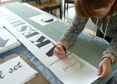 How to transfer lettering onto a wooden sign using only a pencil and printed letters at thehappyhousie