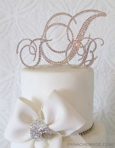 Champagne Monogram cake toppers  and wedding accessories hand embellished with Swarovski crystals.  Add glitz and glam to your wedding cake! www.panachebride.etsy.com