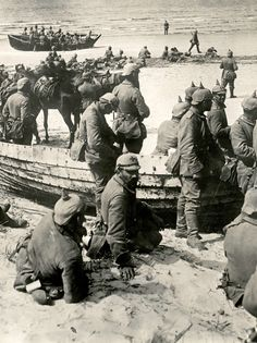 "WW1: German troops prepare to cross a body of water at an unidentified location on the Eastern Front, 1915. The photo is notable in that the troops seem to travel minus their rifles. As for the boats, they don't look very serviceable -- although ""serviceable"" in 1915 had an entirely different meaning."