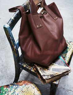Soft Slouchy Bag by Toast. love that clip/buckle/whatever detail peeking out.