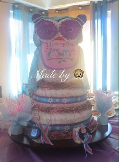 Owl Diaper Cake!!! Made by . Used the tutorial by Thom's Crafts and Treats on YouTube. Thx for the inspiration! It was a great hit at the baby shower.