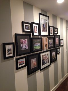 Gallery wall on a striped wall! Islands Framing Gallery in Savannah, GA is a premiere custom framing shop with years of experience in the business, attention to detail, and phenomenal customer service! Call (912) 898-8470 or visit our website www.islandsframing.wordpress.com for more information!