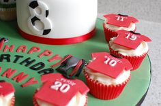 Manchester United themed cupcakes to go with the main birthday cake.       Football shirts made from fondant and are the numbers of the birthday boy's favourite Man U players.    More photos can be viewed on my FB Page www.facebook.com/...