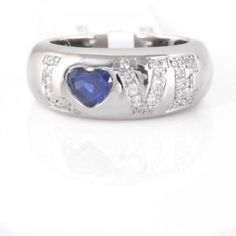 Excellent Condition Chopard Love Ring!! Like new condition Chopard Love Ring. Genuine Blue Sapphire, 18k white Gold, the diamonds equal approximately 1/4 ct with G color and VS clarity. This is iconic Chopard!! It is a ladies size 6.5 but can be sized if needed. 💕No trades, No payments, No Pay Pal 💕 Chopard Jewelry Rings