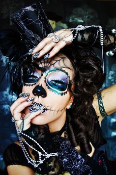 Dia de Los Muertos Sugar Skull makeup  with black bejeweled lips and nails.