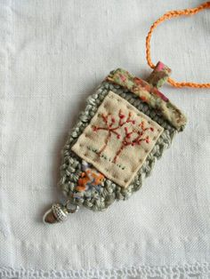 Embroidered tree, crochet, liberty fabric, necklace - Tree embroidered crocheted Liberty fabric necklace by giovabrusa - Textile Jewelry, Fabric Jewelry, Textile Art, Fabric Beads, Fabric Art, Fabric Crafts, Jewelry Crafts, Jewelry Art, Handmade Jewelry