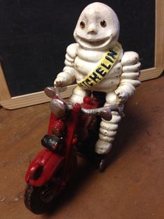 Cast Iron Michelin Man riding his motorcycle! Luv this!  #swagantiqueslv #forsaleatswagantiqueslv #michelinman