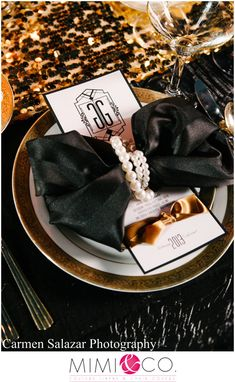 black dinner napkin wrapped in pearls  www.tablescapesbydesign.com https://www.facebook.com/pages/Tablescapes-By-Design/129811416695