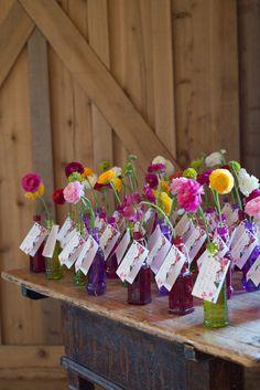 Wedding Flowers Bottles Escort Cards Table Plan http://fromthehipphoto.com/