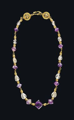 A BYZANTINE GOLD, ROCK CRYSTAL AND AMETHYST NECKLACE - CIRCA 6TH-7TH CENTURY A.D.
