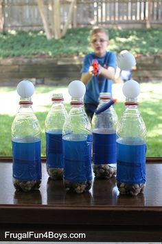 Ping Pong ball Nerf targets--easy to make with some weighted water bottles and ping pong balls.