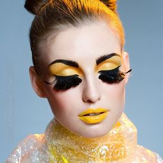 False eyelashes and yellow lips