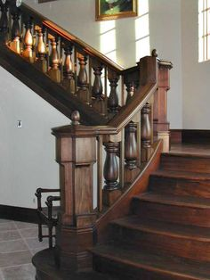 Custom flaired stairway with custom newel posts, railings and balusters.