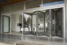 Folding Glass Walls  Eight systems of connected bi-fold door panels offer hundreds of fold-and-stack configurations, with inward or outwar...
