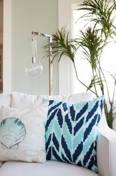 A Los Angeles, beach-style house by designer Eden LA Furniture and Interiors features two indoor/outdoor Rain pillows by Surya (RG-131, RG-172). Zeke Ruelas Photography