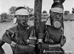The Mursi and the Surma women in Ethiopia are, Salgado says, the last women in the world to wear lip plates. It's unclear precisely why or how this custom evolved, but it is a mark of women of high birth. (2007.)