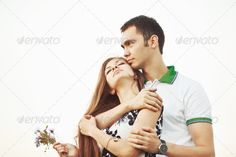 Young couple embracing. ...  Bonding, beautiful, boyfriend, casual, caucasian, cheerful, couple, day, embrace, embracing, friends, girl, girlfriend, heterosexual, hug, life, lifestyle, love, outdoors, outside, people, photography, portrait, relationship, romance, romantic, sensuality, summer, together, togetherness, two, women, young, youth