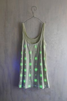 Beneath the Stars Glow in the Dark tank by katastrophicdesign  I haven't worn anything that glows in the dark since I was a child in the 80's, but I like this tank.