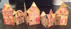 Little houses made with Tim Holtz Artful Dwellings die and Tattered. Lace alphabet bunting.