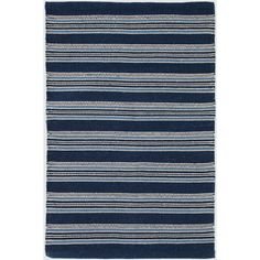 Based on an antique textile found at Brimfield, this indoor/outdoor rug has a rich mix of navy, indigo, and sky stripes.