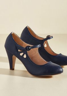 These navy blue Mary Janes are all the reason you need to break out into a little dance! Sashay to work in these retro, vegan faux-leather kicks - or flaunt your fancy footwork on a lunch date in this pair's buckled, cutout-detailed silhouette.