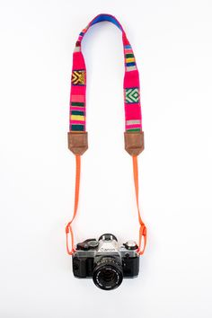 "STRIPED HANDWOVEN FABRICPOP COLORED BACKINGNEON ORANGE WEBBING100% LEATHERADJUSTABLE STRAP51""*Please note these are all made from handwoven fabrics. Each piece is unique in its own way and may have different variations from what is photographed. Each item is authentic*"