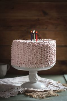 Raspberry Ombre Cake with Whipped Cream Cheese Frosting. Plus, a cake decorating tutorial and a giveaway!