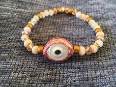 Ceramic evil eye bracelet with 6 mm czech crystal stones by FsMade