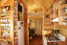"""Erin and Dondi Harner in Colorado have their 100 percent off-grid tiny house has just recently been completed and contains all the necessities for a totally self-contained 181 square foot home on wheels. The couple named their home """"Soleil"""" because it runs off the sun."""