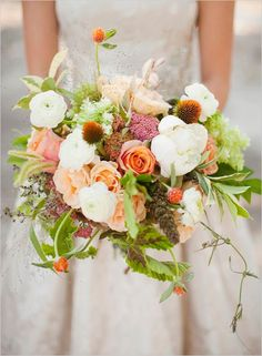 Natural, wild bridal bouquet - ranunculus, roses, gomphrena, and greens