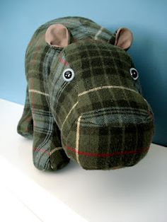 Stuffed Hippo, alternative to a memory bear.  This hippo was made from an outgrown flannel shirt that belonged to the customer's high school boyfriend that is now her husband. Funky Friends Factory pattern