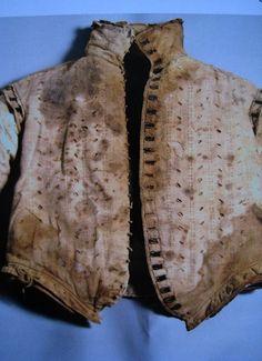 Pinked linen doublet of Antonella Petrucci. St. Domenico Maggiore, Naples.  Extant male clothes of the Italian Renaissance