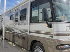 2005, Winnebago Adventurer 37B Original Owner. INTERIOR FEATURES: Ceramic Floors, Carpet, Maple Cabinets, Corian Counter Tops, Full Kitchen, Conv. Microwave, Stove Top, Split Bath, Shower w/ Glass Door, Skylight, 2 TV's with DVD - See more at: http://www.rvregistry.com/used-rv/1003188.htm#sthash.sK7YZVsy.dpuf